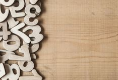 Pile random numbers on wooden table. Closeup image with pile numbers on wooden table Royalty Free Stock Image