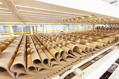 Closeup image of pleat cardboard row at factory background.  Royalty Free Stock Image