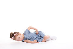 Closeup image of a pretty little girl sitting on the floor. Closeup image of a pretty little girl sitting on the floor on a white background Royalty Free Stock Photography