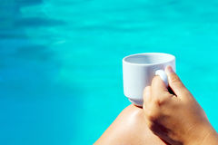 Closeup image of real attractive female beauty holding cup of co Royalty Free Stock Photos