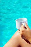 Closeup image of real attractive female beauty holding cup of co Stock Images
