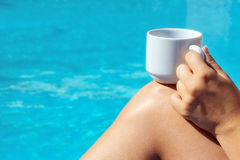 Closeup image of real attractive female beauty holding cup of co Royalty Free Stock Images