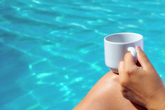 Closeup image of real attractive female beauty holding cup of co Stock Photos