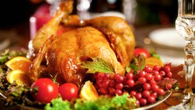 Closeup photo of roasted chicken on big dish on Christmas dinner table. Closeup image of roasted chicken on big dish on Christmas dinner table royalty free stock photos