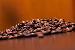 Closeup image of roasted coffee grains Stock Images