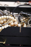 Pearls and jewellery overflowing from a box Royalty Free Stock Image