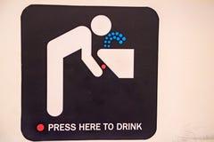Public drinking fountain sign close up Stock Photos