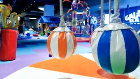 Closeup image of small carousel for children covered with soft mats for kids safety on the palyground at shopping mall. Closeup photo of small carousel for stock image