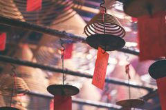 Spiral incenses hanging from the ceiling in Chinese temple. Closeup image of spiral incenses hanging from the ceiling in Chinese temple stock photo