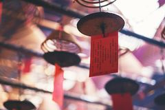 Spiral incenses hanging from the ceiling in Chinese temple. Closeup image of spiral incenses hanging from the ceiling in Chinese temple stock image