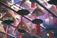 Closeup image of spiral incenses hanging from the ceiling. In Chinese temple royalty free stock images