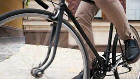 Closeup image of stylish man riding vintage bicycle on street. Closeup photo of stylish man riding vintage bicycle on street Royalty Free Stock Image