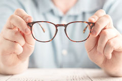 Closeup image: two hands holding classic glasses Royalty Free Stock Image
