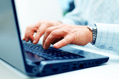 Closeup of typing male hands Stock Photography