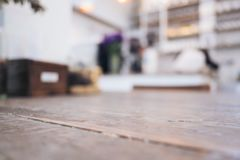 Closeup image of vintage wooden table foreground with blur background. In cafe Stock Images
