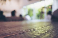 Closeup image of vintage wooden table foreground with blur background. In cafe Royalty Free Stock Images