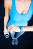 Closeup image of a woman with activity tracker Stock Photo