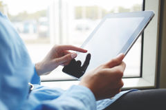 Closeup image of woman is booking on-line via portable digital tablet. Royalty Free Stock Photo