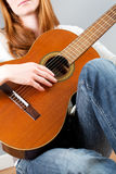 Closeup image of a woman with a guitar Royalty Free Stock Photo