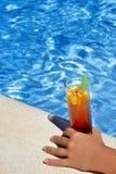 Closeup image of woman hand holding cocktail Stock Photos