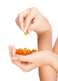 Woman hands with pillls Royalty Free Stock Image