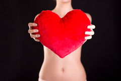 Closeup image of a woman holding red heart Stock Image