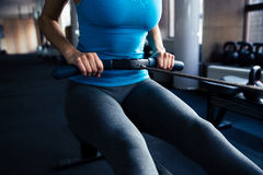 Closeup image of a woman working out on simulator Stock Image