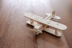 A wooden airplane on the table stock image