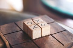 Wooden Tic Tac Toe game or OX game in a box. Closeup image of wooden Tic Tac Toe game or OX game in a box Stock Photos