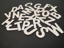 Closeup image of wooden white alphabet letters with black color background. stock photos