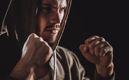 Closeup image of young gangster is fighting with fists.hand blow. Closeup image young gangster is fighting with fists..hand blow. virile strength Royalty Free Stock Photo