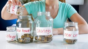 Closeup photo of young woman saving money to buy new house stock photo