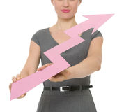 Closeup on increasing arrow holding by girl female Stock Image