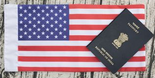 Closeup of Indian passport on USA or america`s flag as a background stock photos