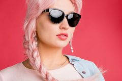 Blonde woman on pink background stock photography