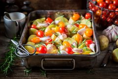 Closeup of ingredients for roasted potato with tomatoes Royalty Free Stock Photography
