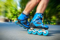 Closeup of Inline roller skater on a slalom course. Stock Photos