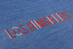 Closeup inscription Los Angeles, inlaid rhinestones on denim. Royalty Free Stock Photos
