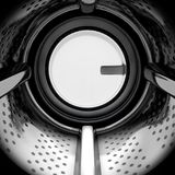Washing Machine Drum. A closeup from the inside of the drum of an industrial washing machine looking outwards towards the shut door - 3D render vector illustration