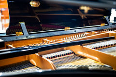 Closeup inside grand piano. Musical instrument vintage. Stock Images