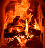 Closeup of the inside of home traditional fireplace. Running on natural hard wood with flames and heat Royalty Free Stock Images