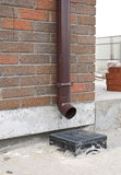 Closeup on Installed Rain Gutter and Drainage System. Stock Photos