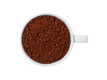 Closeup instant coffee in cup isolated on white background Royalty Free Stock Photography