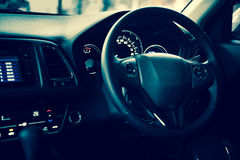 Closeup interior modern car console with full windscreen show sp Stock Photos