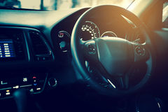 Closeup interior modern car console with full windscreen show sp. Ace of front seat and passenger cabin , gear box , steering wheel and whole of dashboard Royalty Free Stock Images