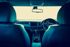 Closeup interior modern car console with full windscreen show sp. Ace of front seat and passenger cabin , gear box , steering wheel and whole of dashboard Royalty Free Stock Image
