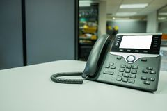Closeup ip phone deveice on office desk royalty free stock image