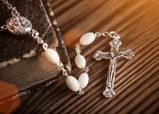 Closeup of iron Christian cross with holy Bible. Royalty Free Stock Image