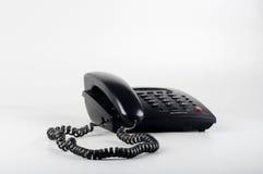 Closeup of an Isolated black landline phone Stock Photo