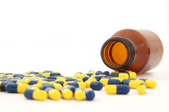 Closeup of isolated capsules spilling out Stock Photo
